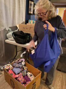 Volunteer packing the items