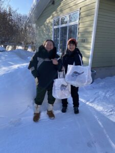 Geraldine Penney and Denise Pyke delivering bags in Hayriver